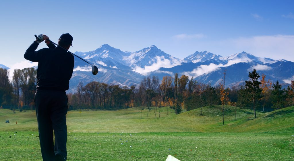 Golfer over great nature